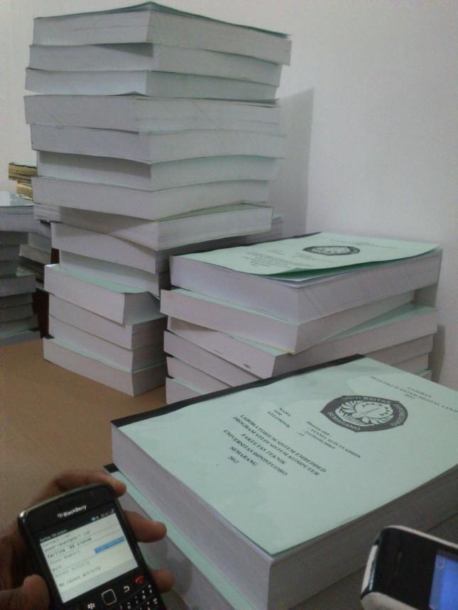 tumpukan laporan SDL